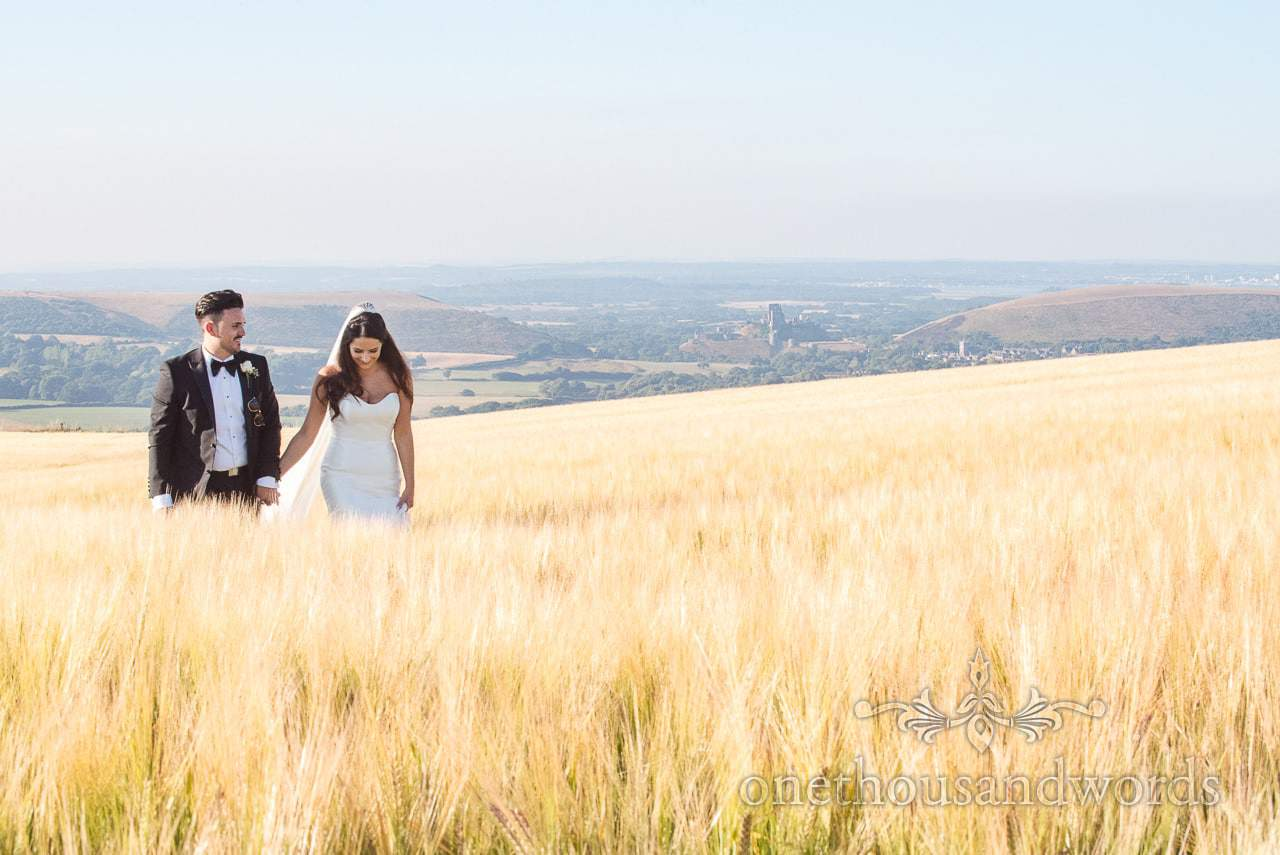 Newlyweds walk hand in hand at Country Courtyard Wedding