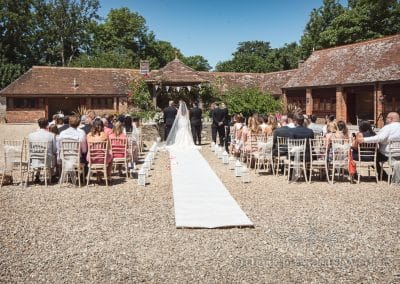 Outdoor ceremony in the sunshine at Country Courtyard Wedding