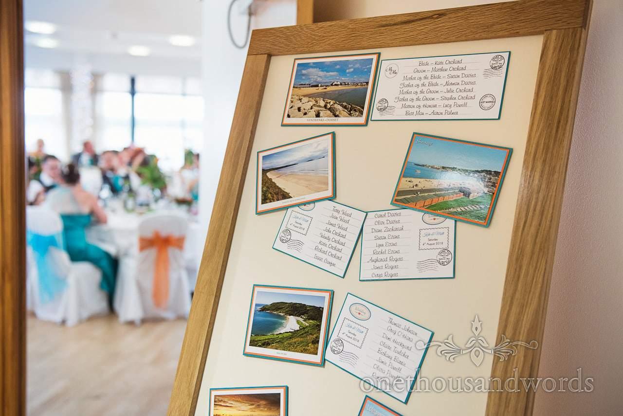 Postcard wedding table plan at RNLI College Wedding breakfast