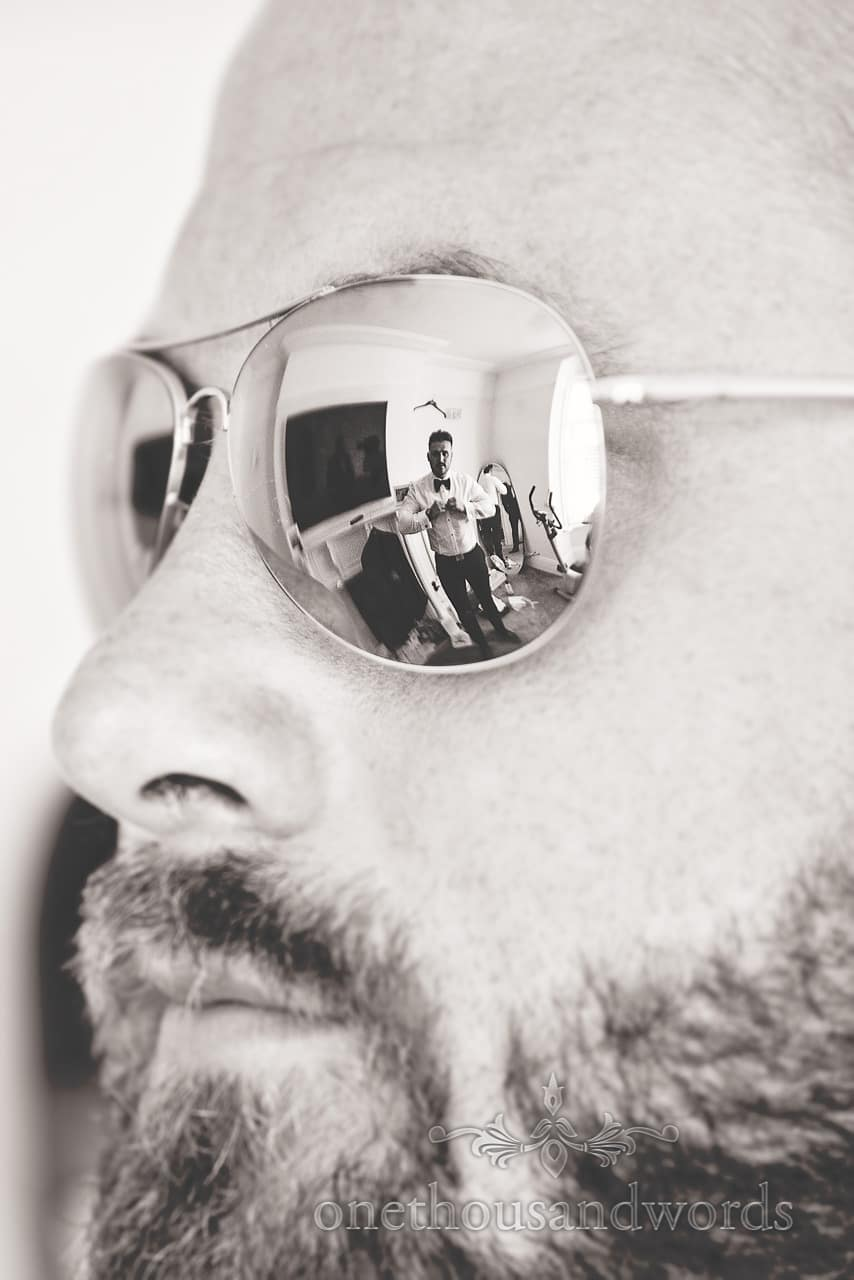 Reflection of groom in groomsman's sunglasses from Courtyard Wedding
