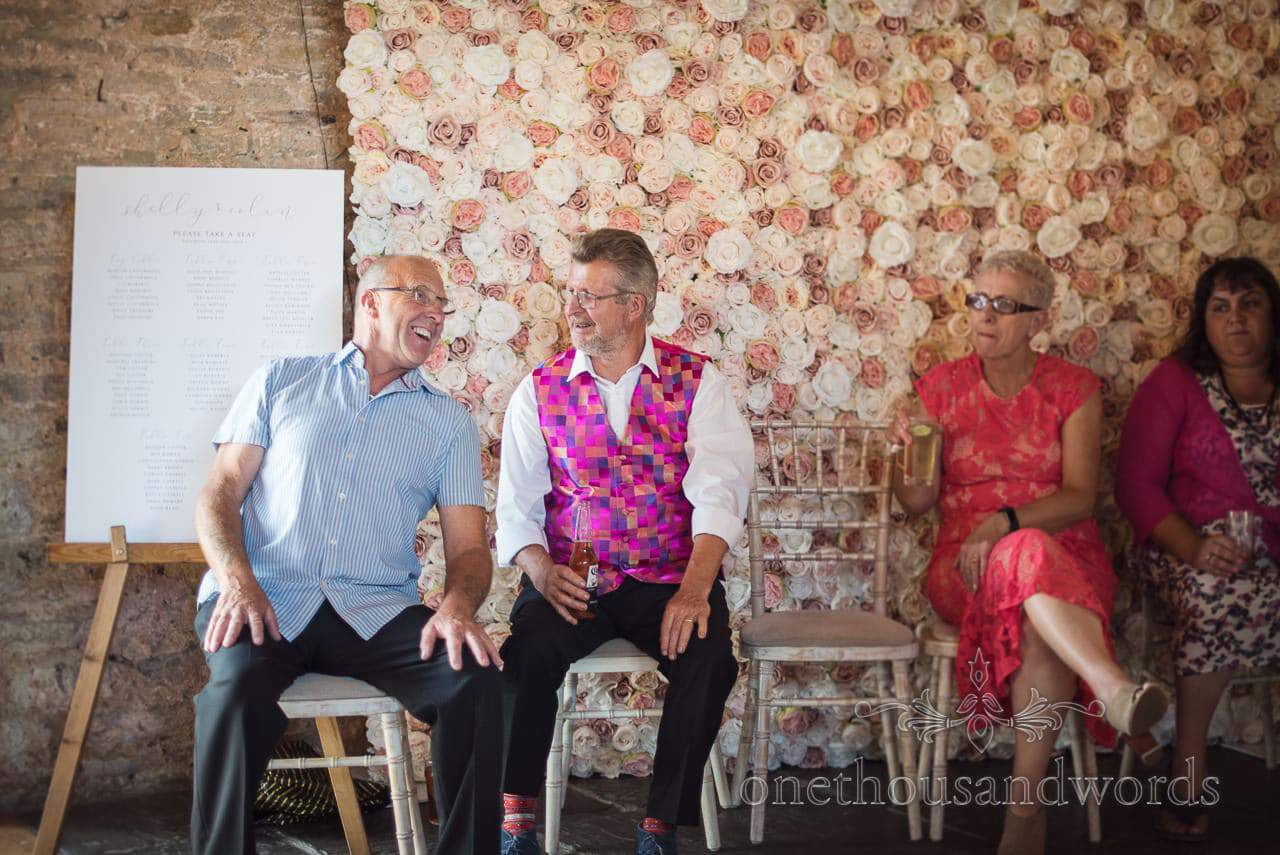 Seated guest with fancy waistcoat at Purbeck Courtyard Wedding