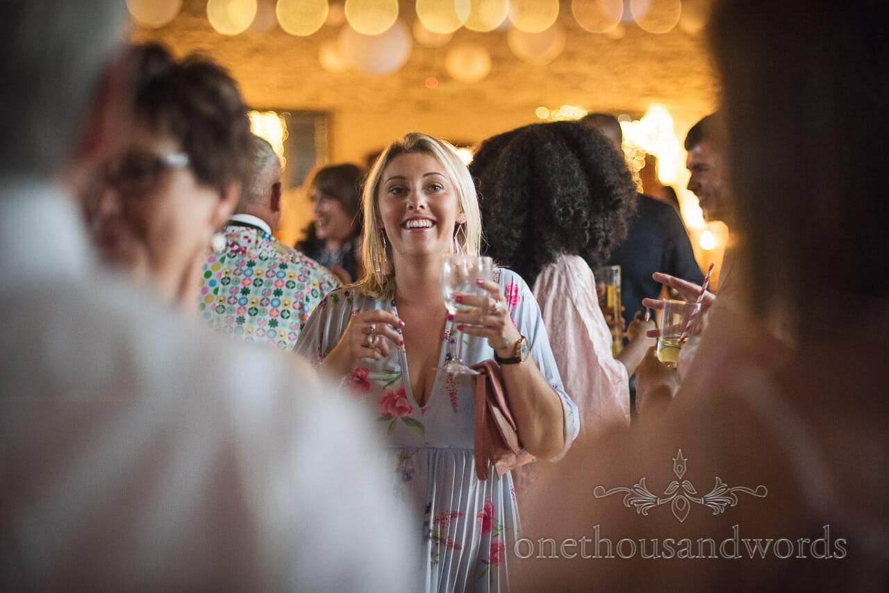 Smiley guest on the dance floor at Purbeck Courtyard Wedding