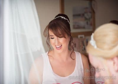 Smiling bridesmaid on morning of RNLI College Wedding Photographs