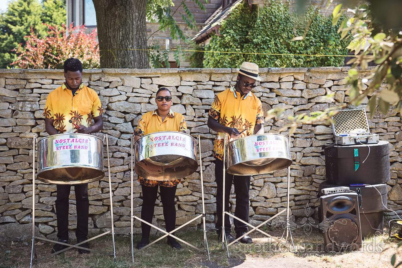 Steel band play during garden drinks reception at Country Courtyard Wedding