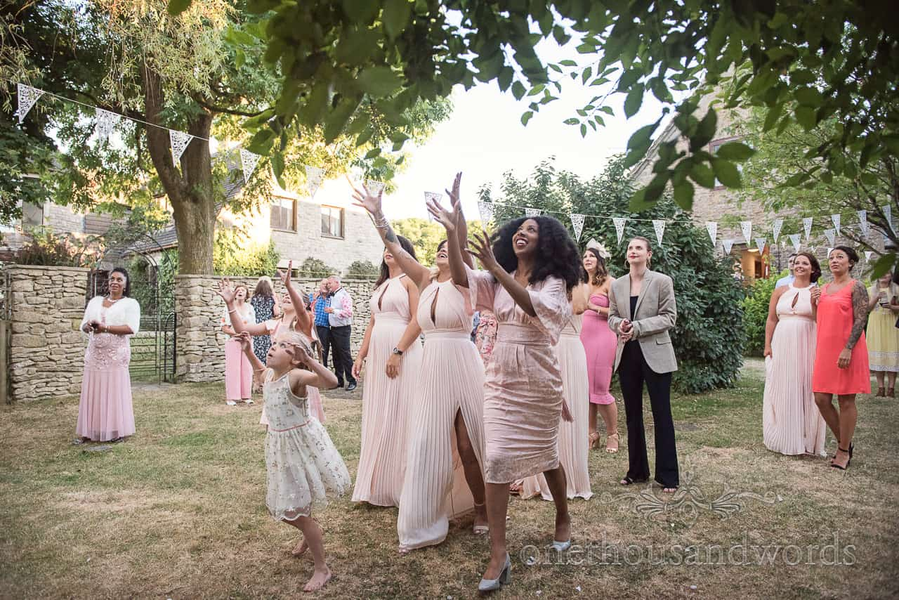 The bouquet is in the air at Country Courtyard Wedding