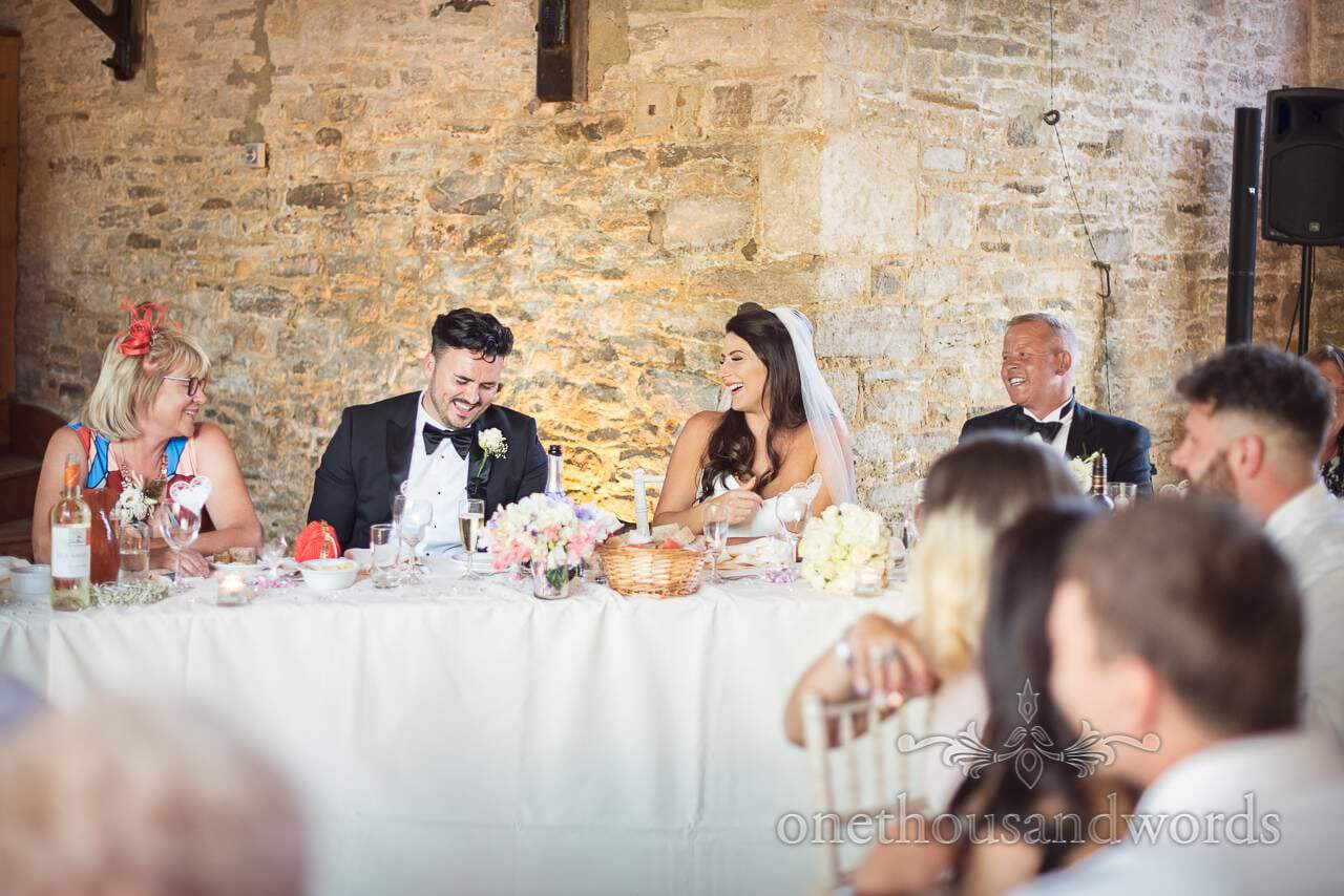 Top table reactions during speeches from Country Courtyard Wedding
