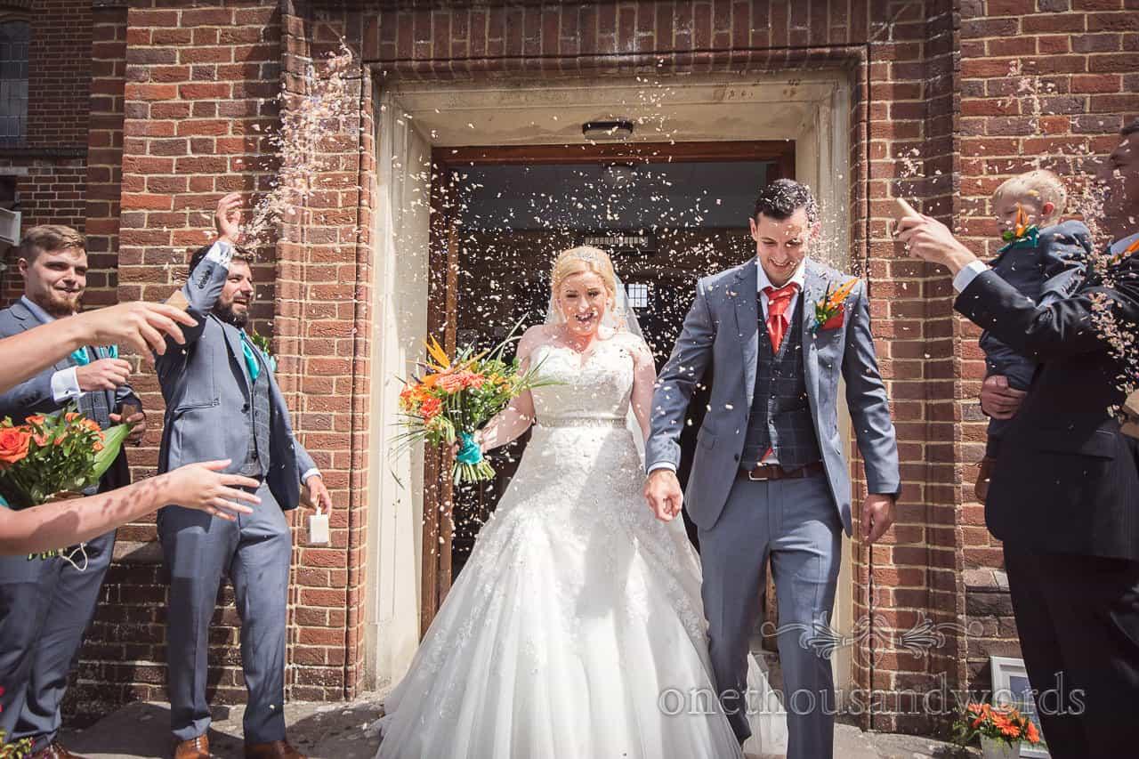 Wedding confetti photograph at St Michael's church wedding venue in Hamworthy