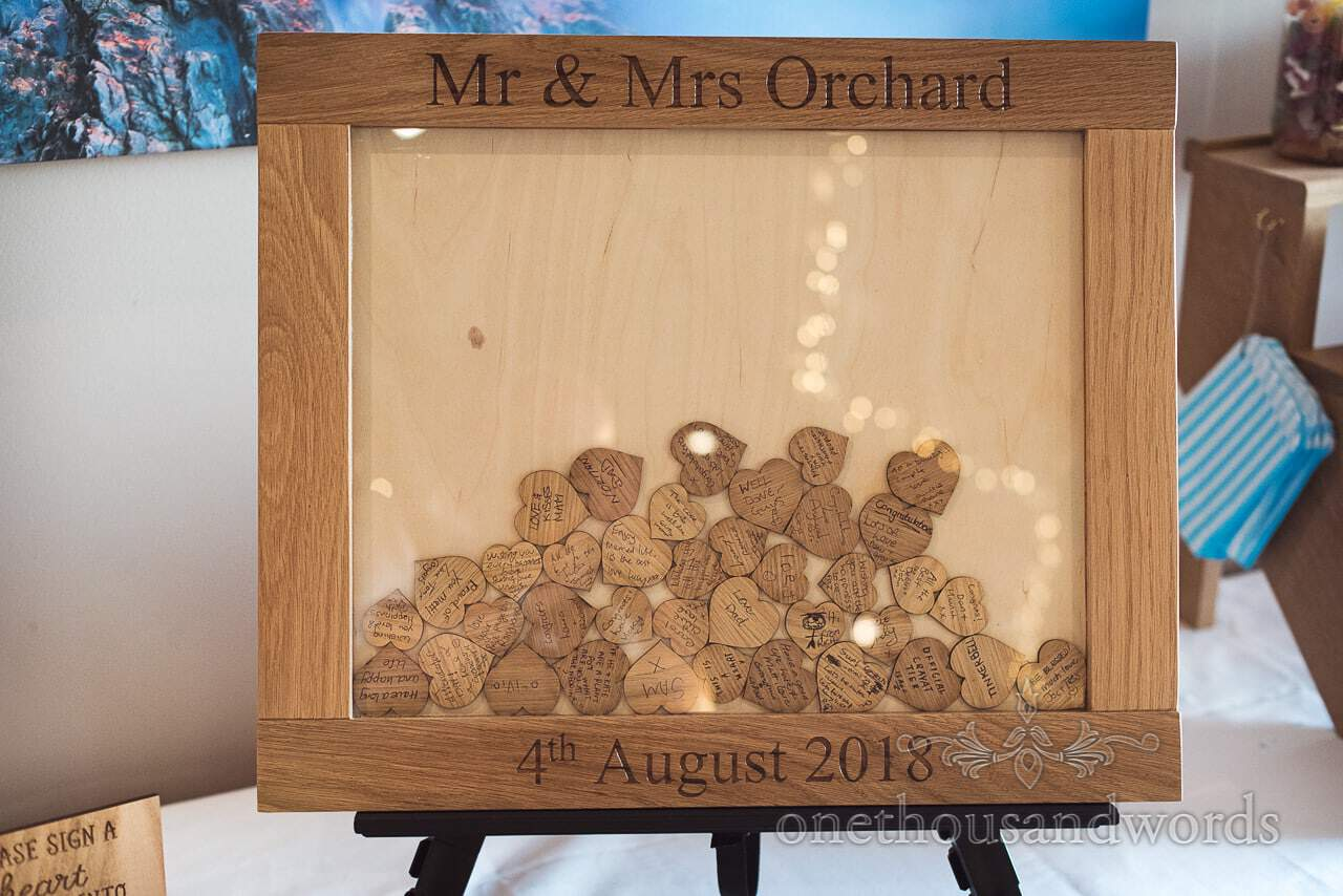 Wedding guest frame wooden hearts with messages for bride and groom