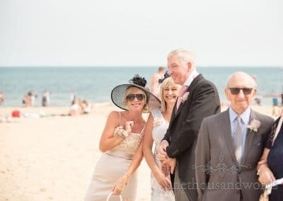 Wedding guest on Sandbanks beach during summer seaside wedding in Sandbanks