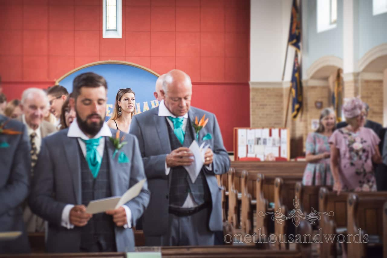 Wedding guest sings at wedding ceremony at St Michael's church in Poole