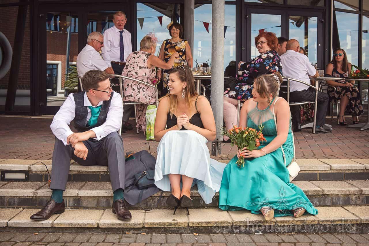 Wedding guests enjoy sunshine at RNLI College Wedding drinks reception