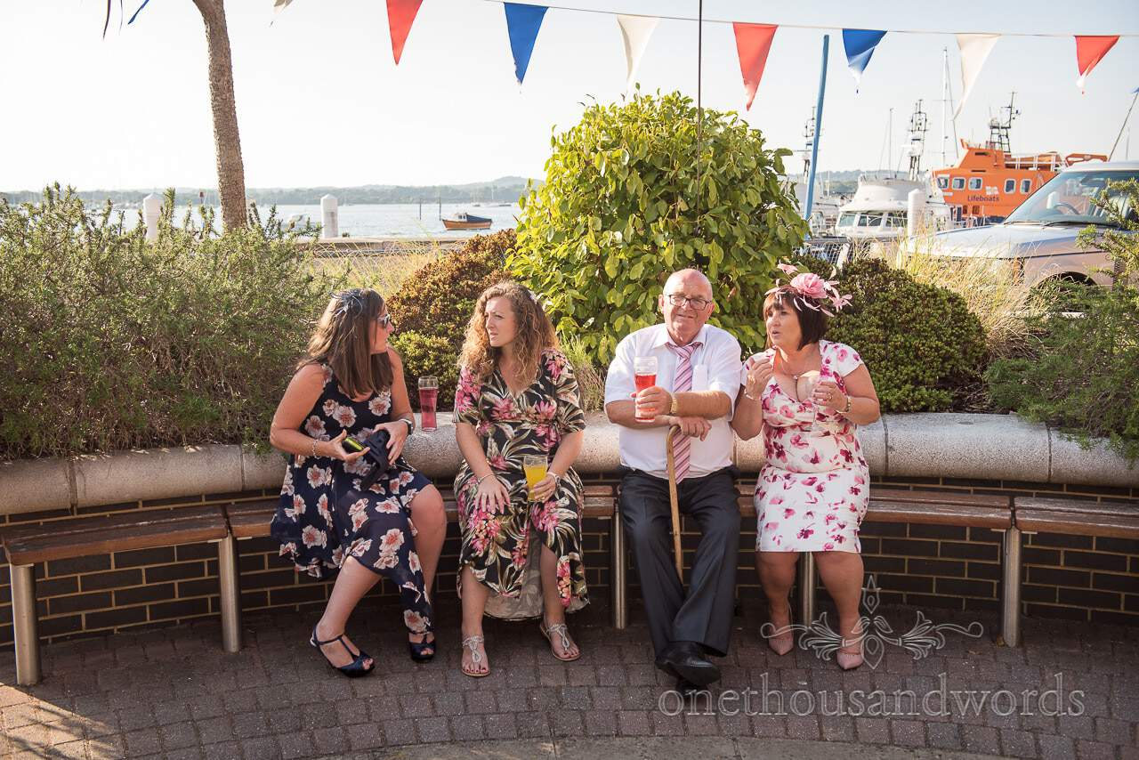 Wedding guests enjoy wedding drinks reception at RNLI College Wedding