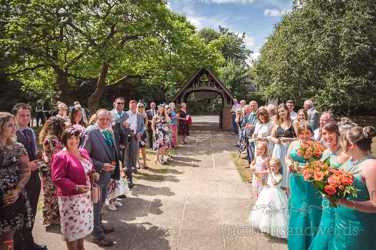 Wedding guests gather for throwing confetti St Michael's church in Hamworthy Poole