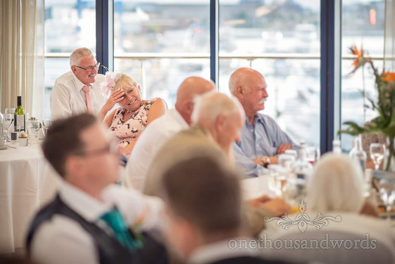 Wedding guests laughing at speeches in observation rooms at RNLI College