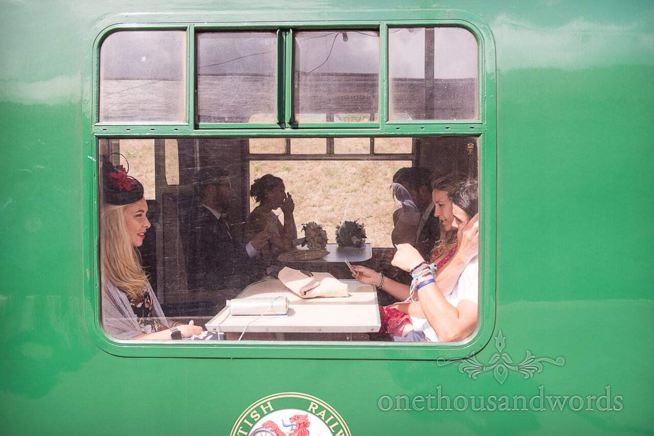 Wedding guests sit on Swanage steam train on way to wedding reception