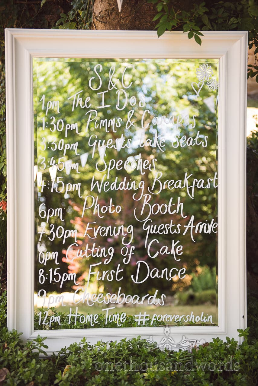 Wedding order of service written on mirror at Country Courtyard Wedding
