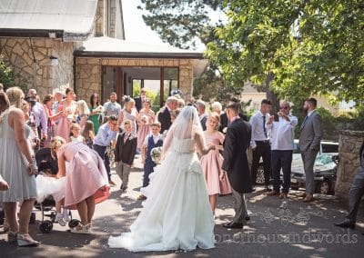 Wedding party outside Lady of the transfiguration church in Sandbanks, Poole