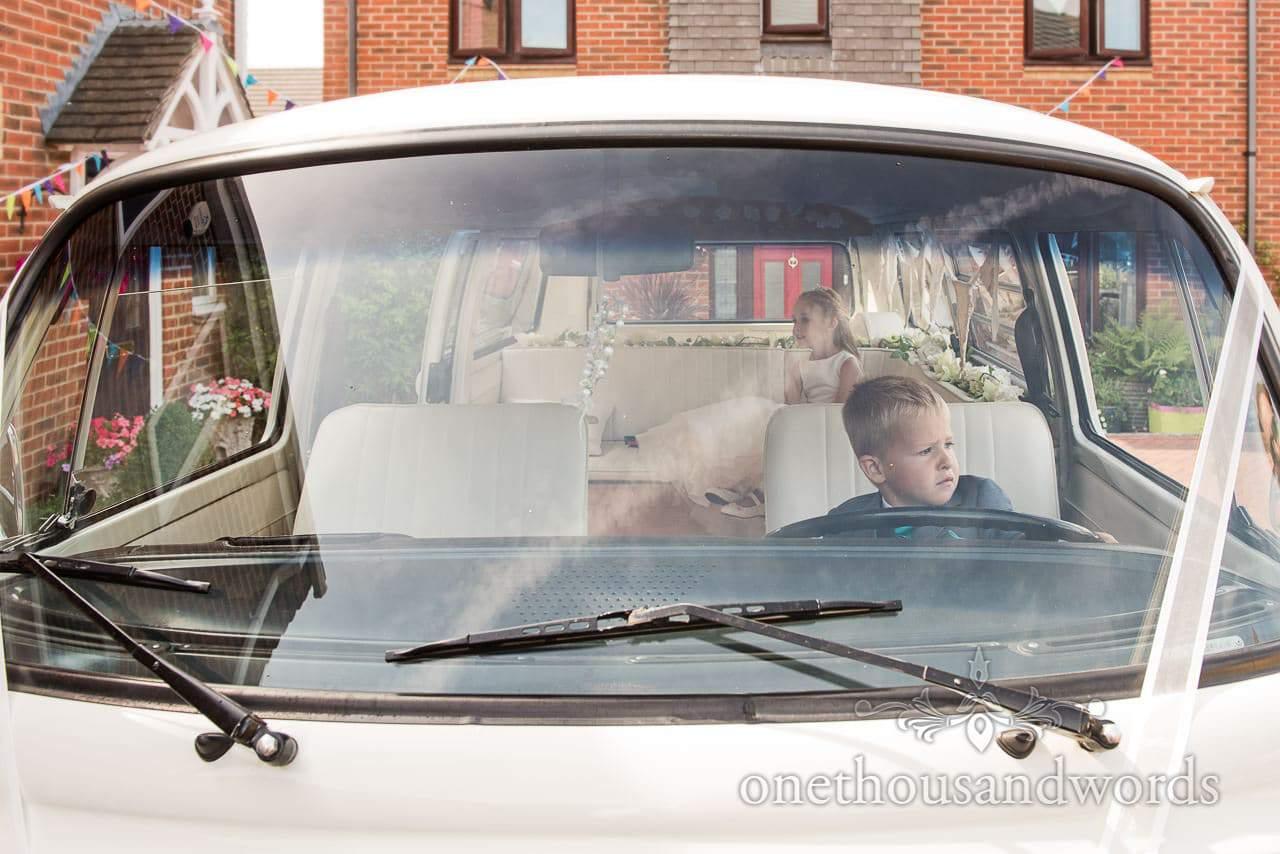 Wedding Photographs of flower girl and page boy in wedding VW camper van