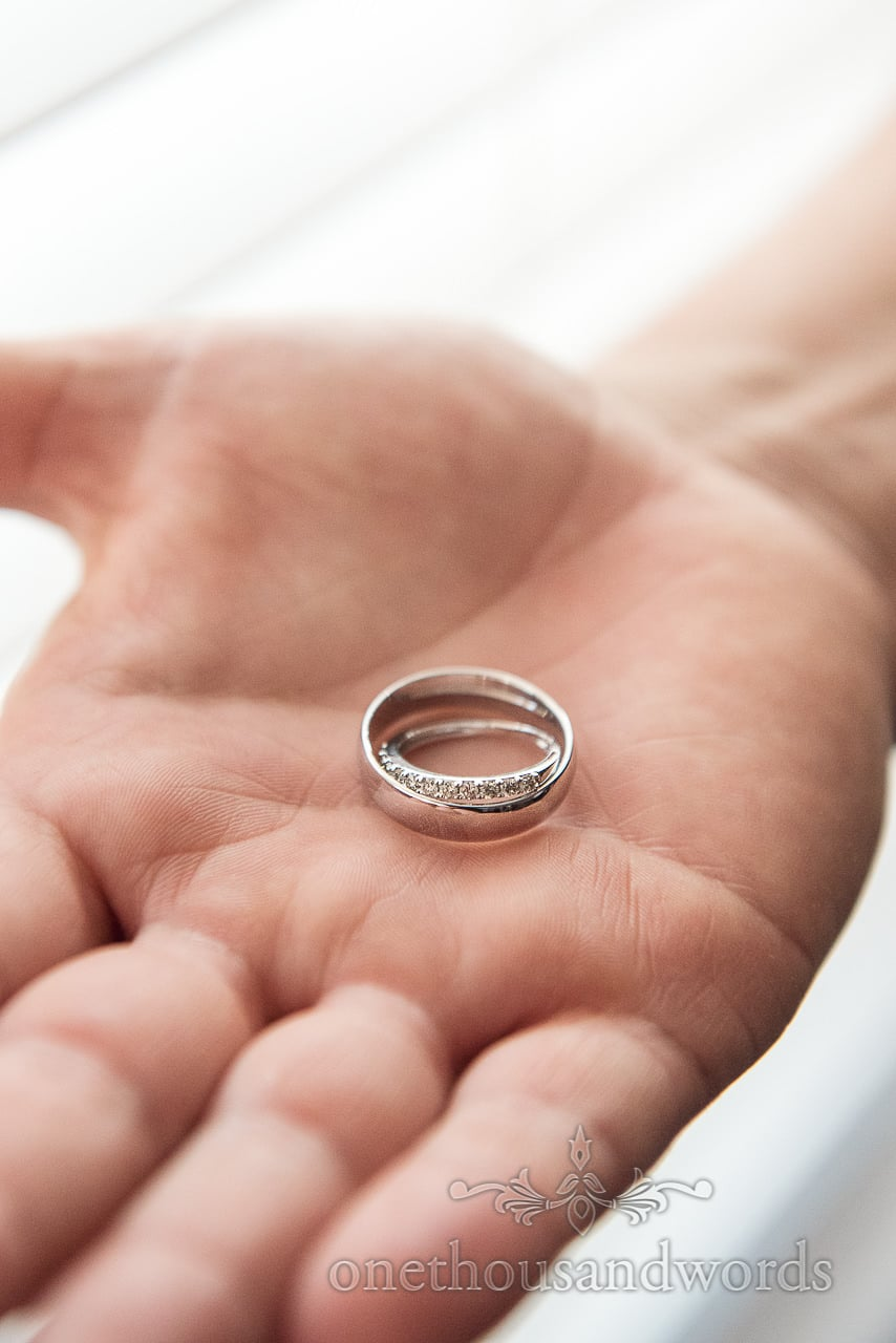 Wedding rings in the palm of hand from Courtyard Wedding