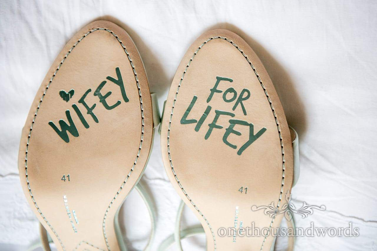 Wedding shoes with Wifey for Lifey written on stitched leather soles