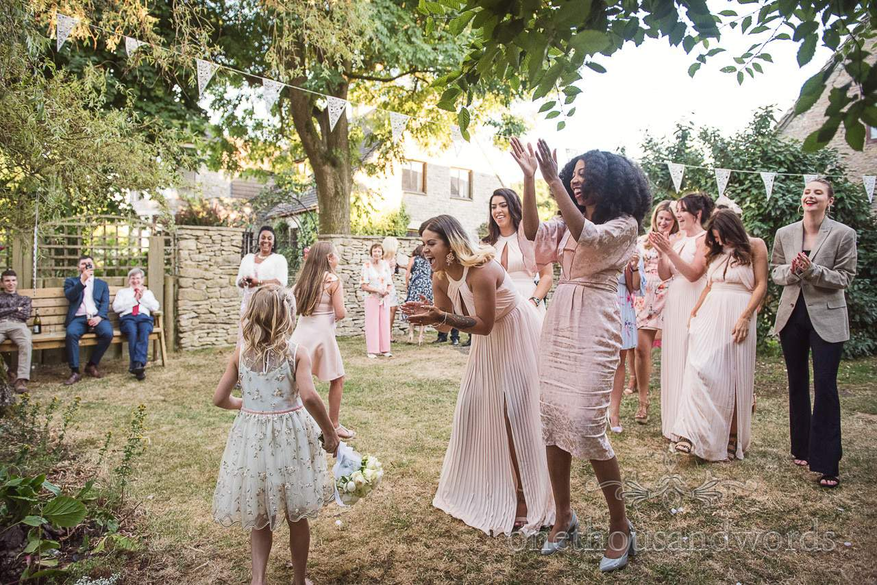 Young wedding guest get bouquet at Kingston Courtyard Wedding