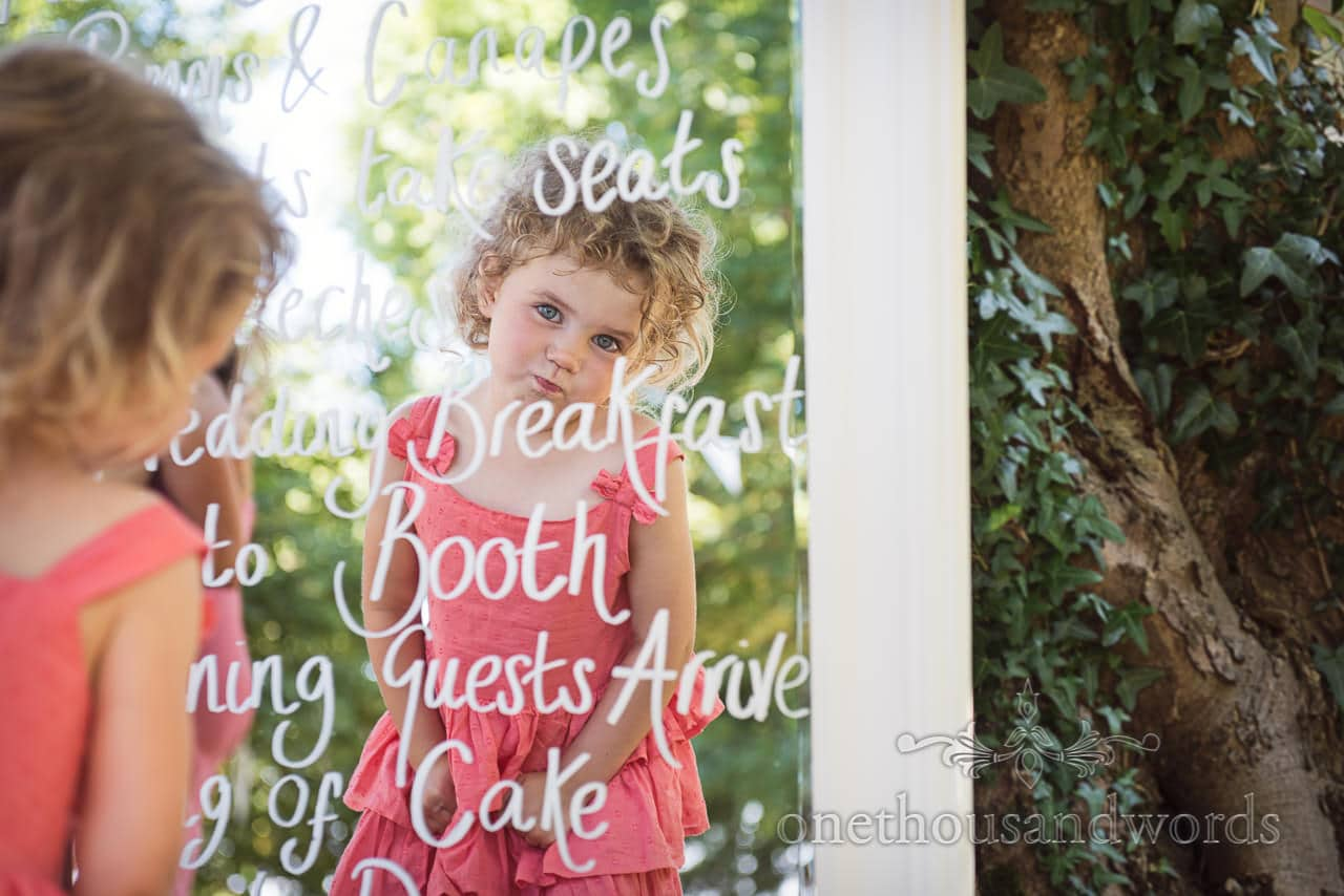 Young wedding guest in mirror order of the day at Country Courtyard Wedding