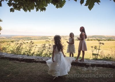 Young wedding guests and the view at country Courtyard Wedding