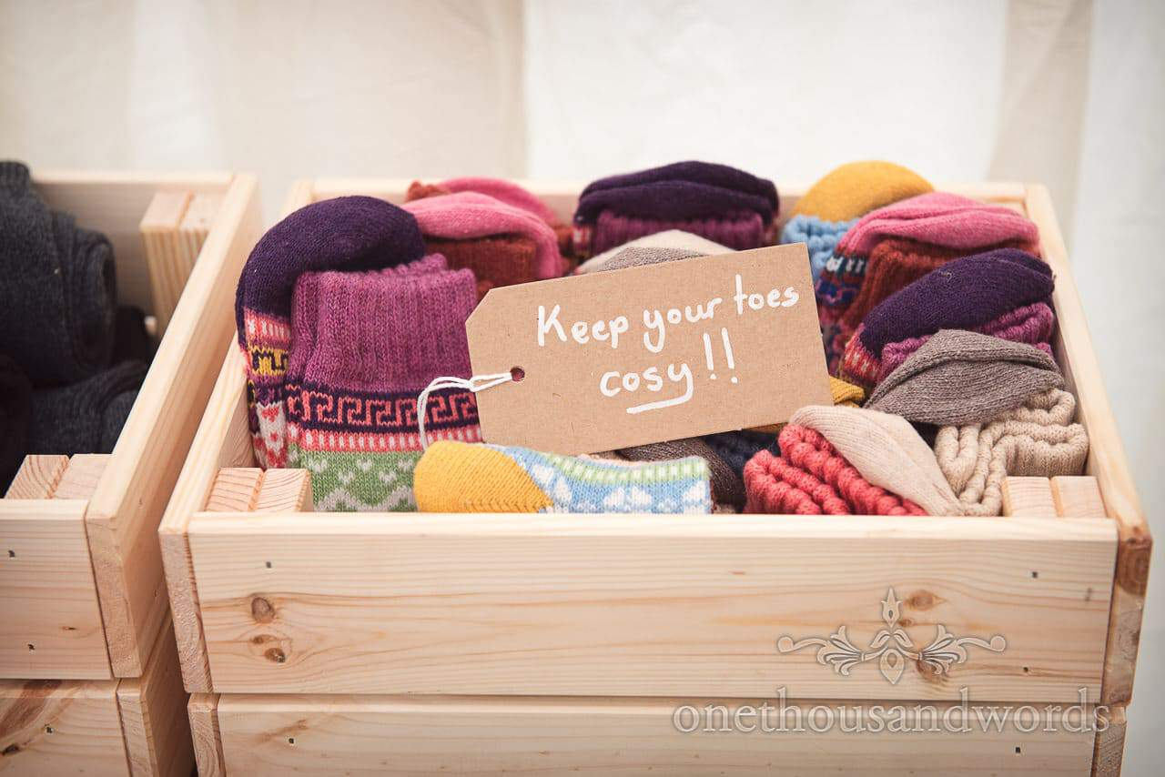 A box of socks with message for guests at Dorset garden wedding