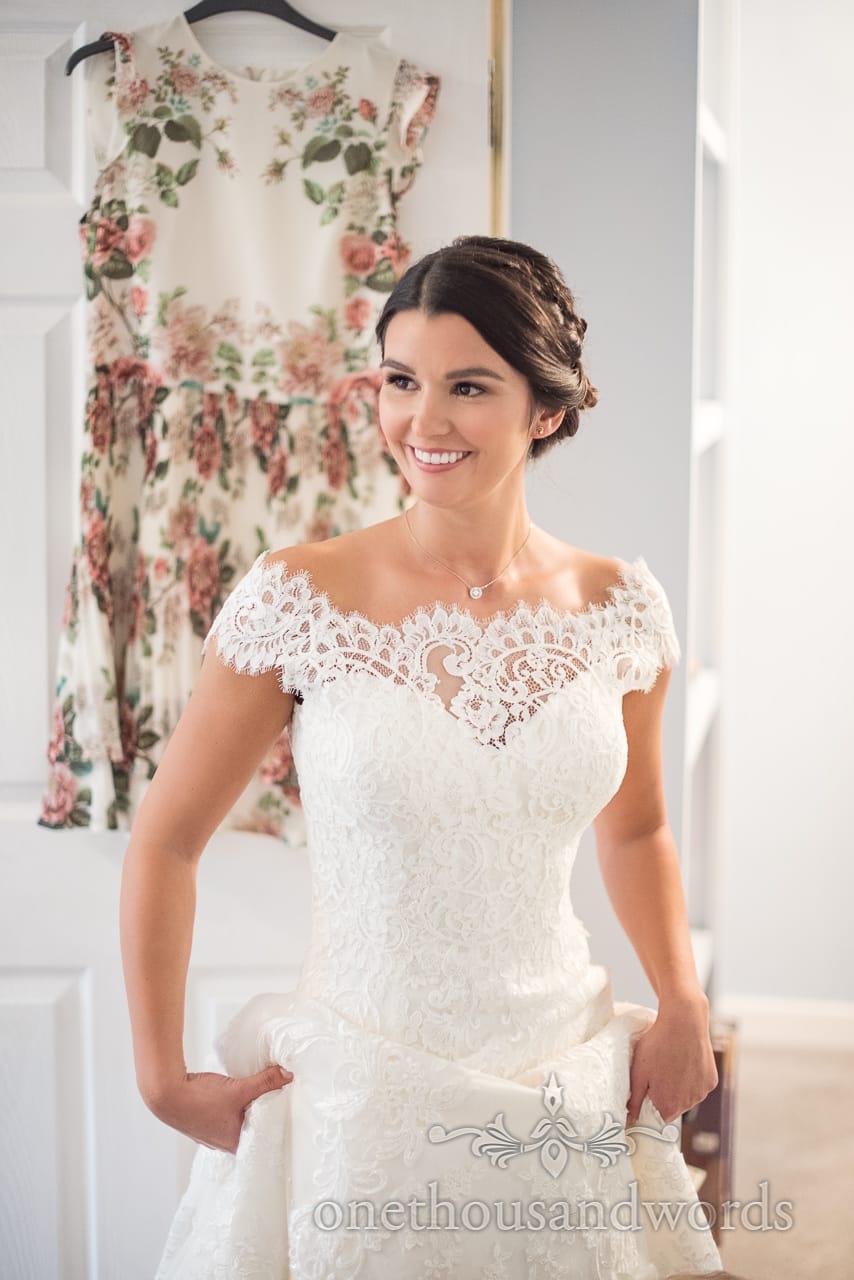 Beaming bride in wedding dress before Italian Villa Wedding