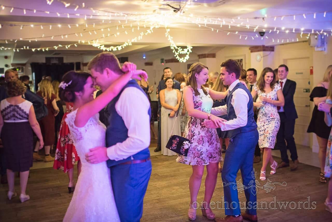 Best man and partner join bride and groom on dance floor at Italian Villa