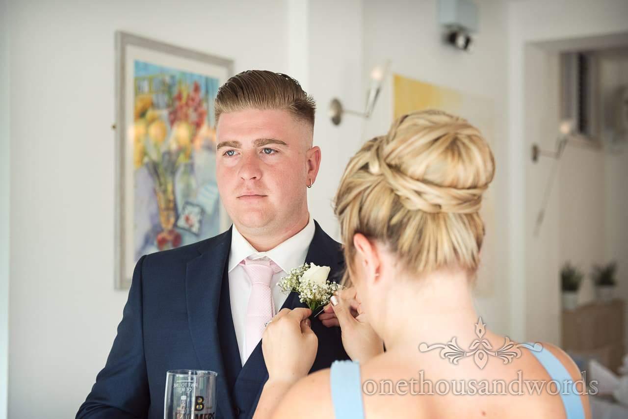 Best man had buttonhole pinned by bridesmaid at Italian Villa Wedding