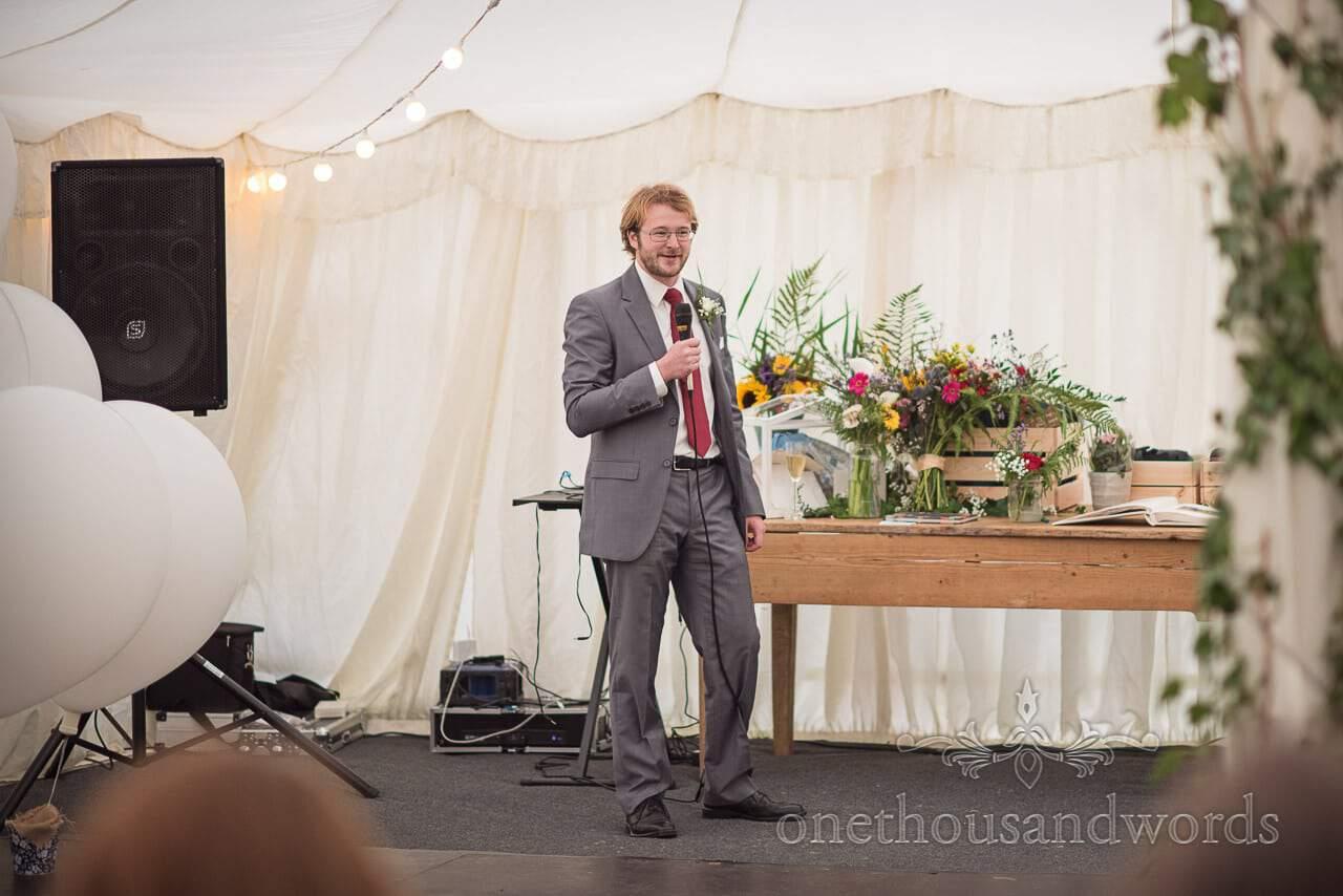 Best man delivers speech at Dorset garden wedding