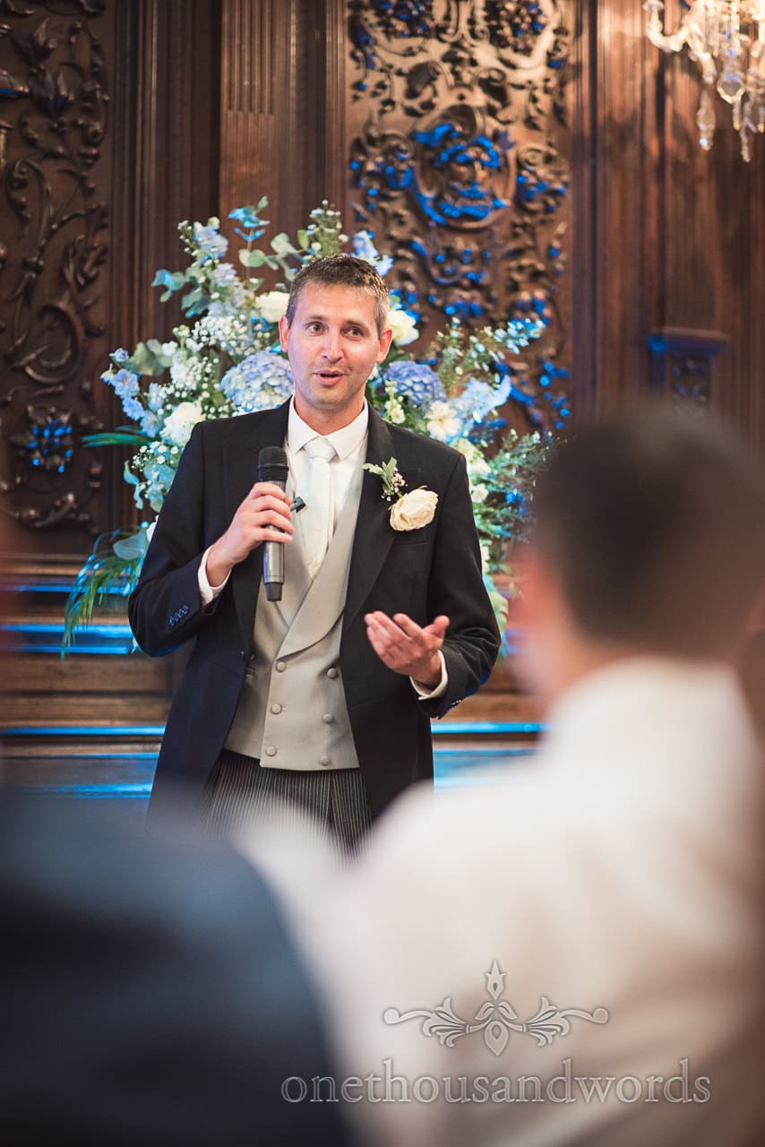 Best man delivers speech in great hall at School Wedding Photographs