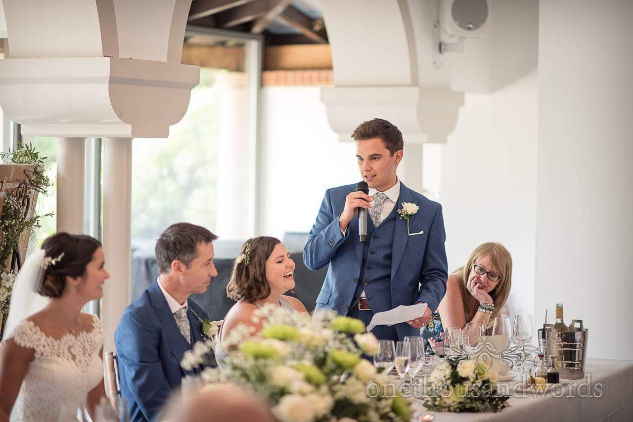 Best man in blue suit gives best man's speech at The Italian Villa wedding venue