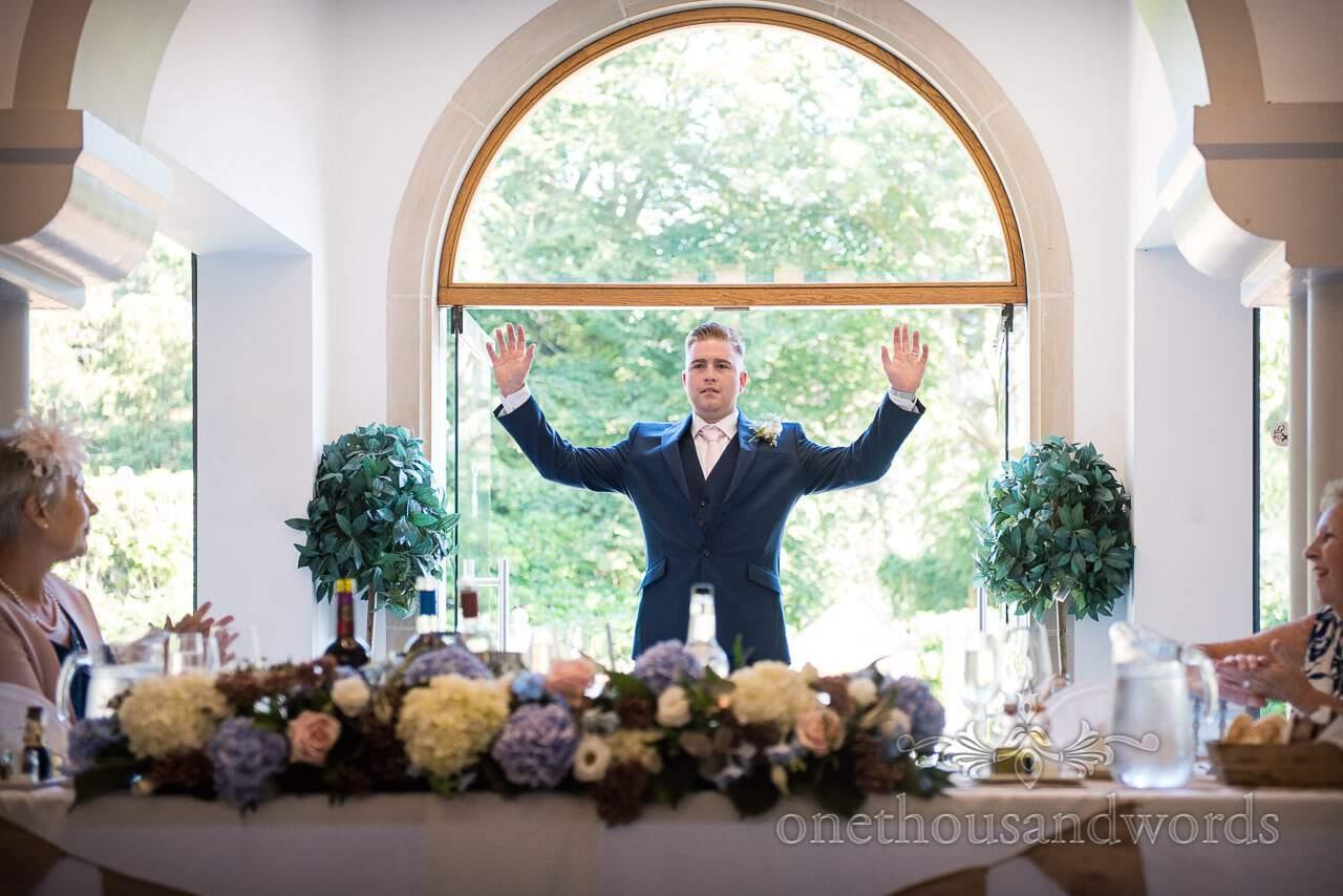 Best man make his entrance at Italian Villa Wedding venue photos