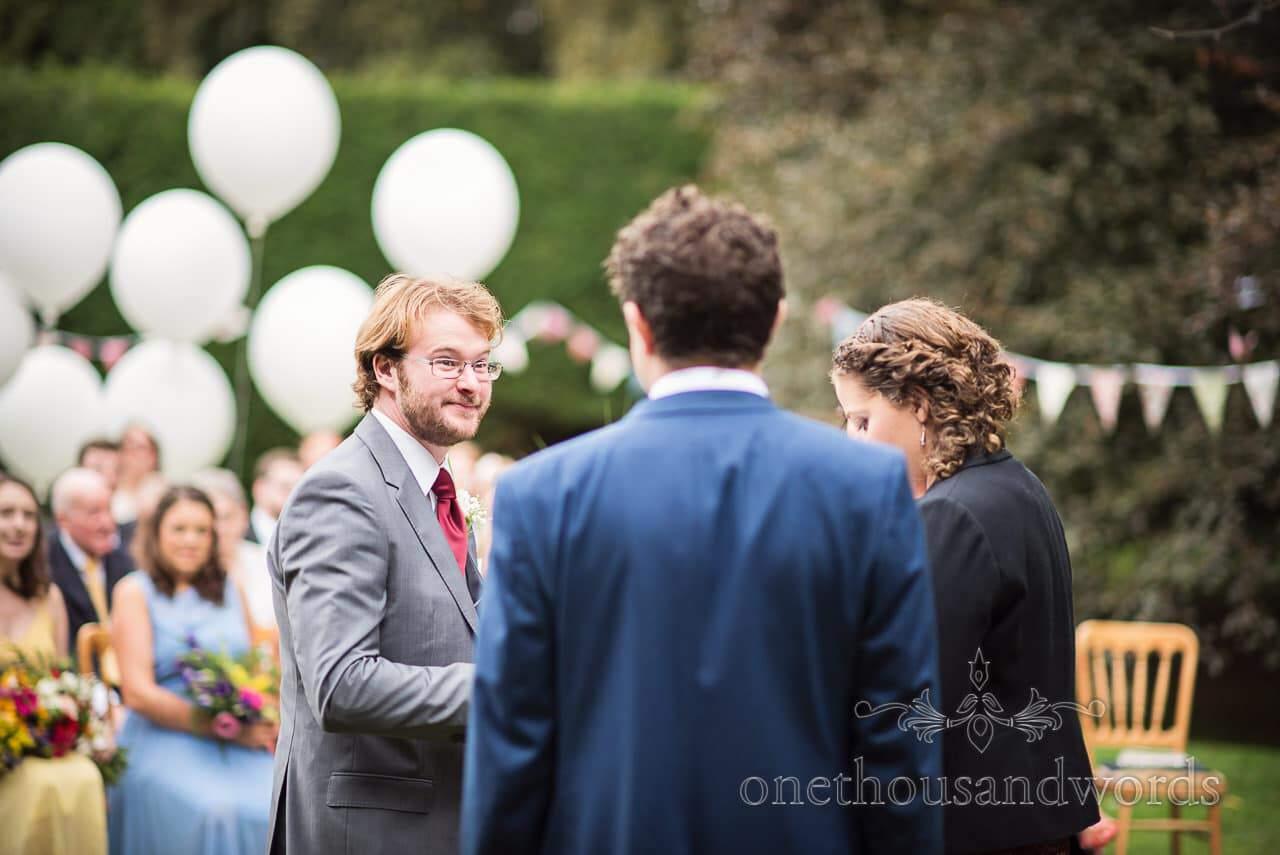 Best man presents rings at Dorset garden wedding