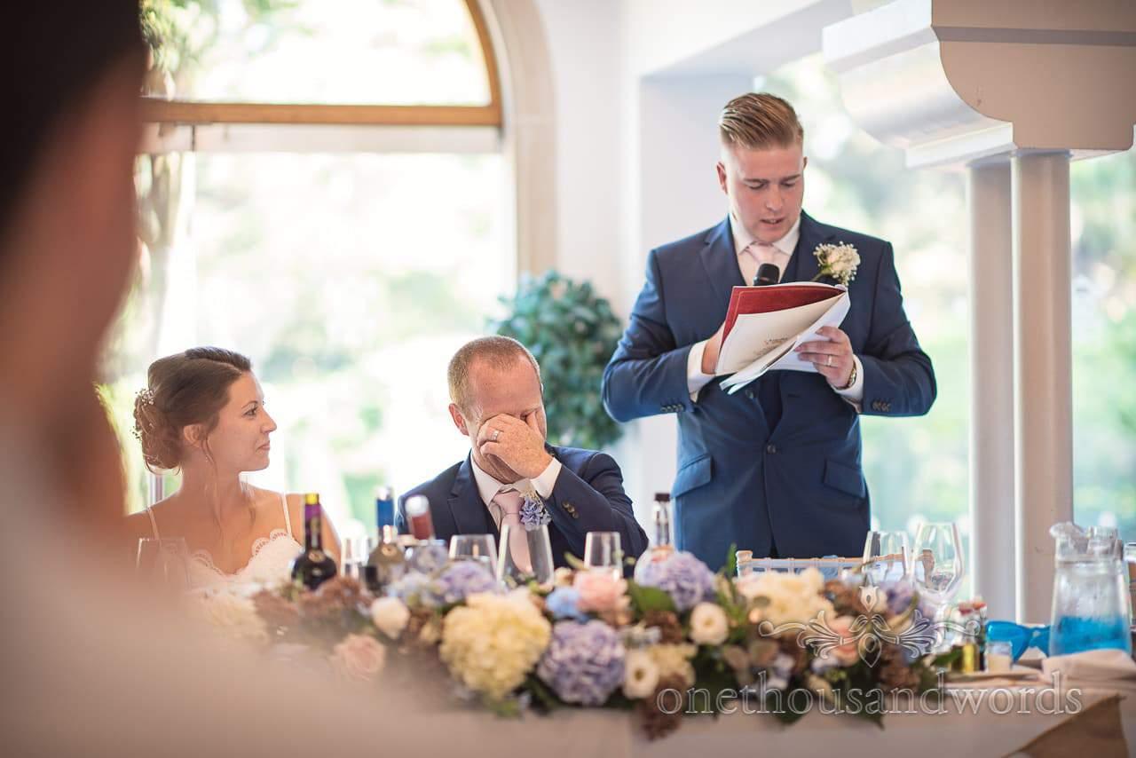 Best man reads his speech during wedding breakfast at Italian Villa