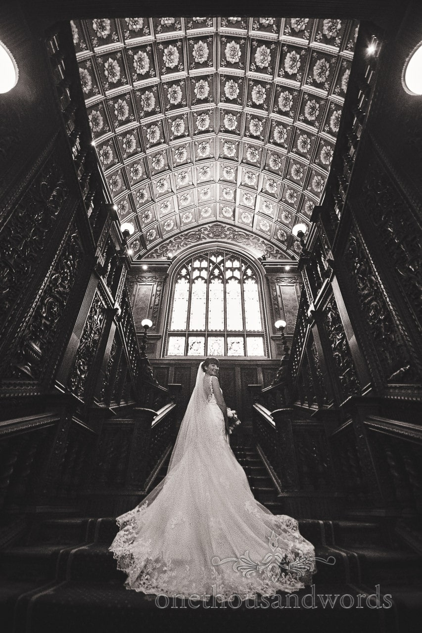 Black and white photo of bride on staircase at Canford School Wedding Photographs