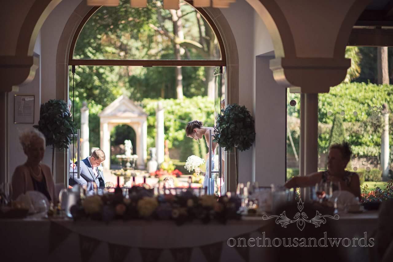 Bridal party prepare to make entrance at Italian Villa Wedding venue photos