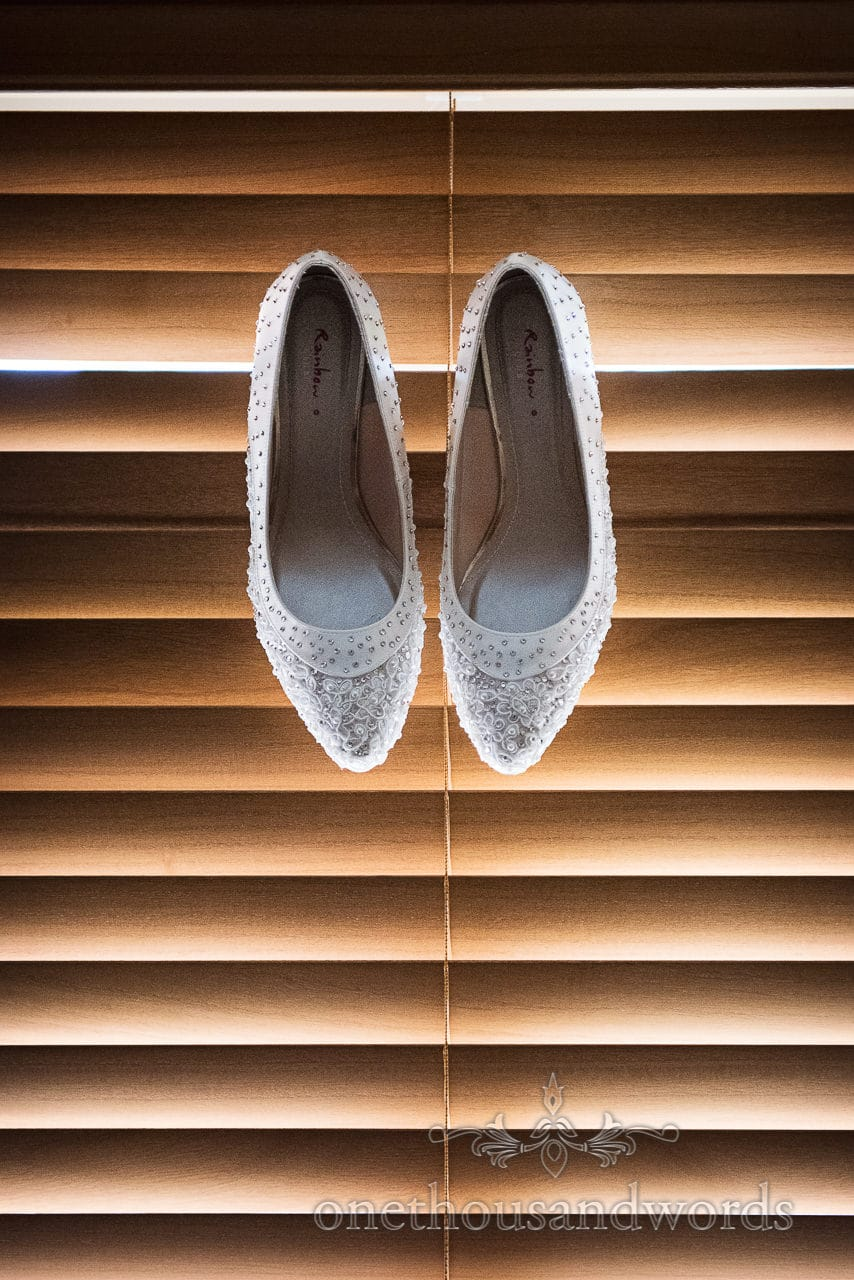 Bridal shoes on blind from Canford School Wedding