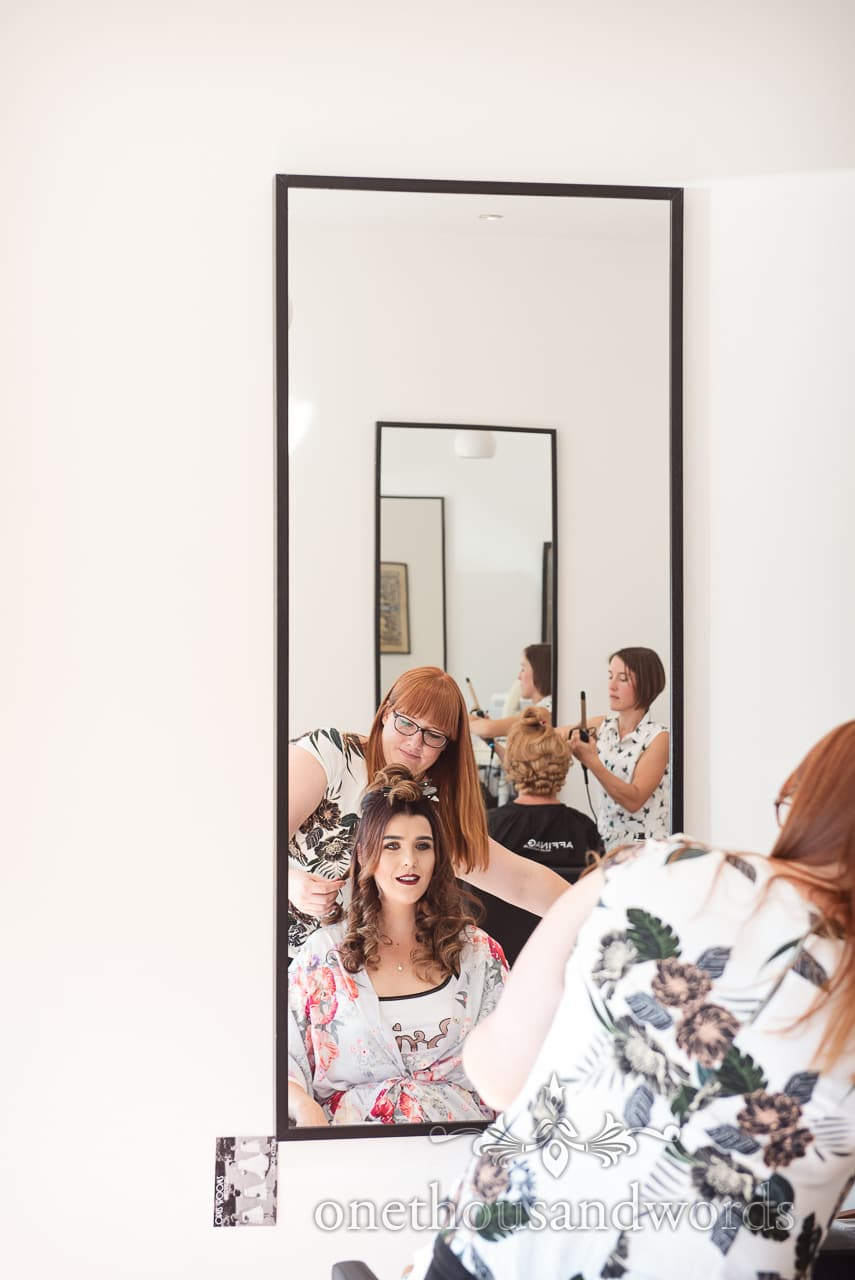 Bride and bridesmaid have hair styled on morning of Old Vicarage Wedding