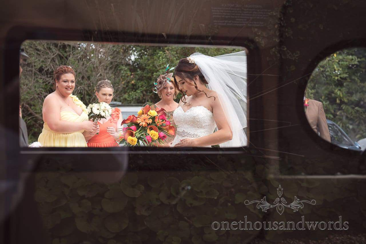 Bride and bridesmaid through wedding car window at Old Vicarage Wedding