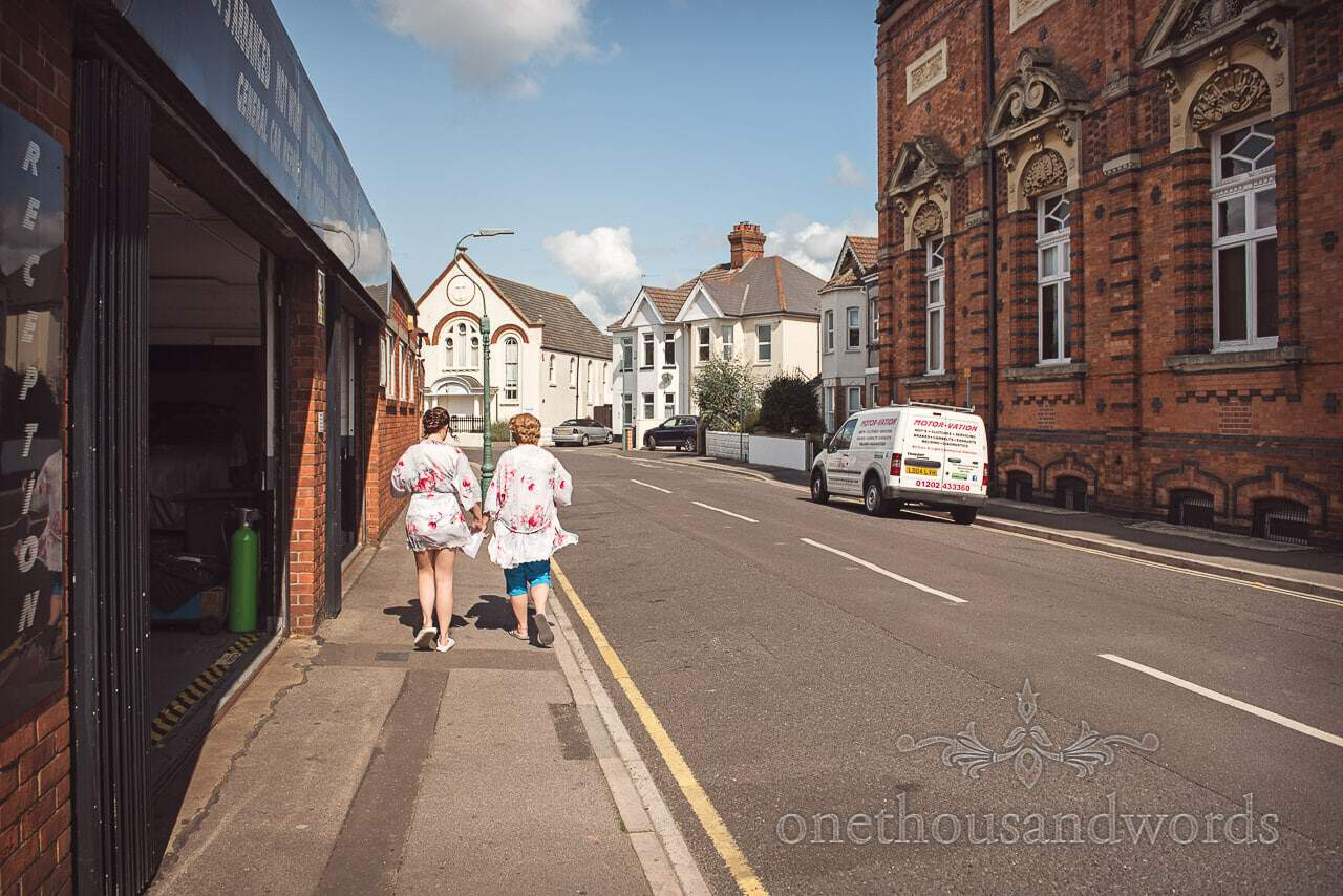 Bride and bridesmaid walk back from the salon before Old Vicarage Wedding