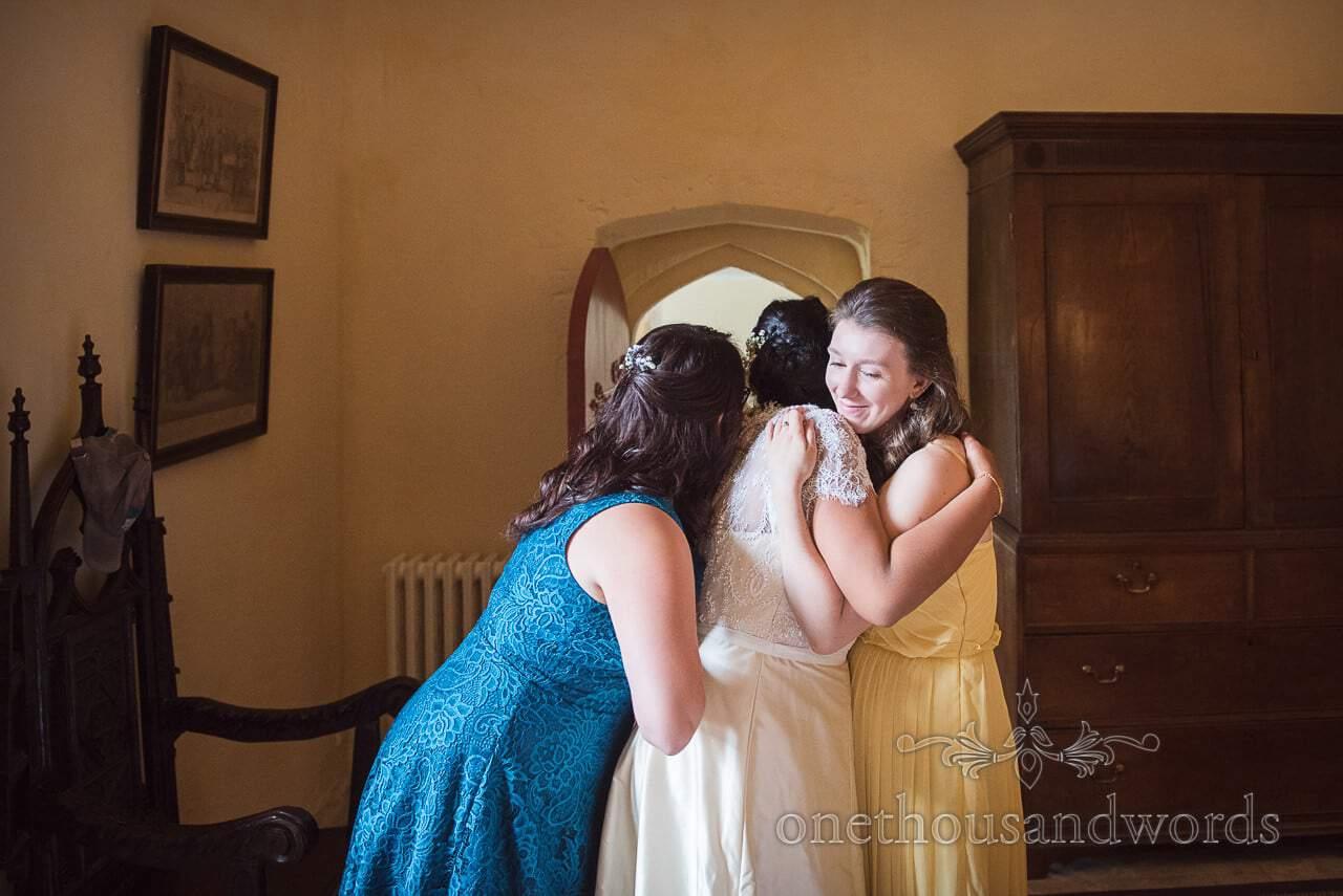 Bride and bridesmaids embrace on morning of Garden Wedding