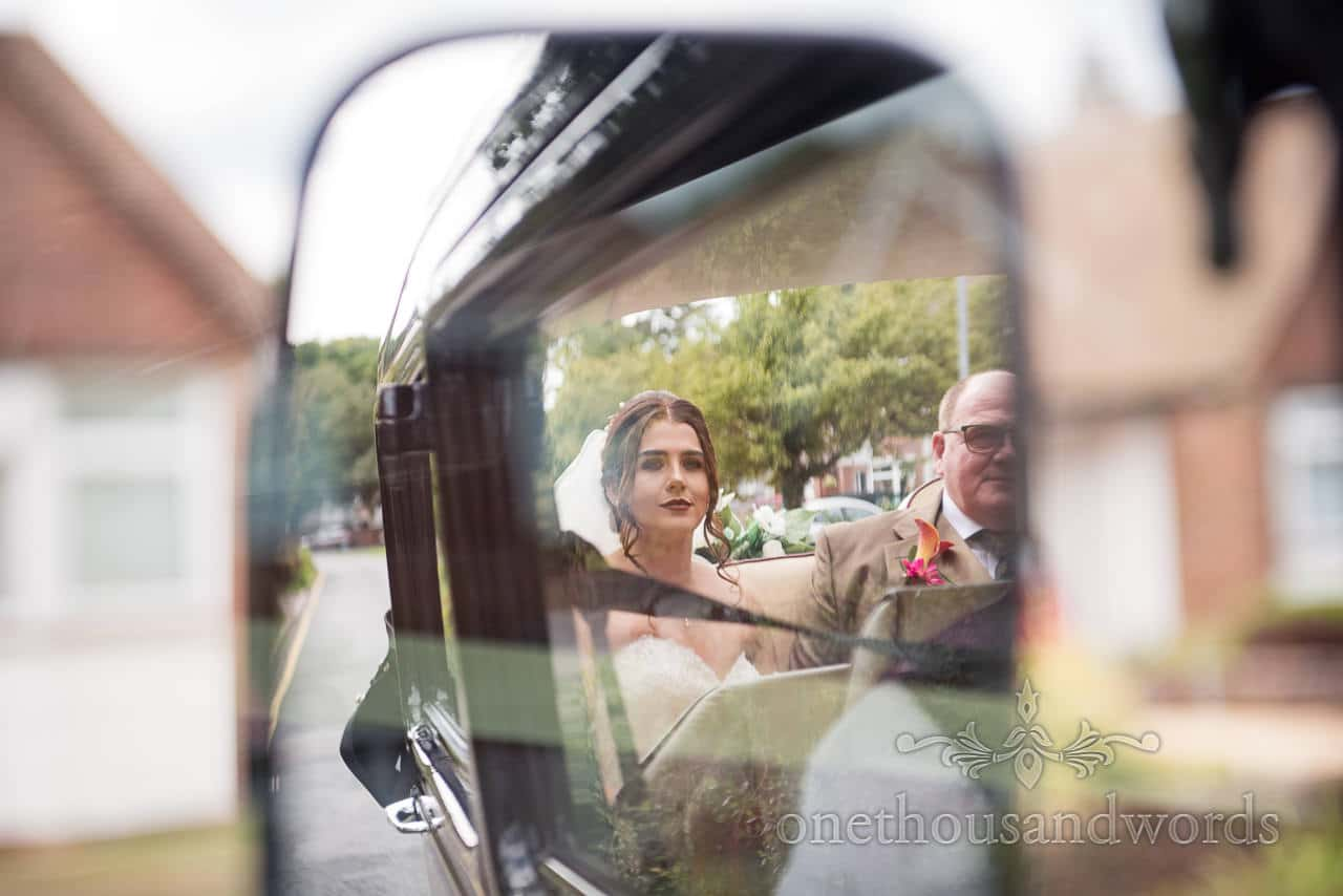 Bride and father reflection in wedding car mirror from Old Vicarage Wedding