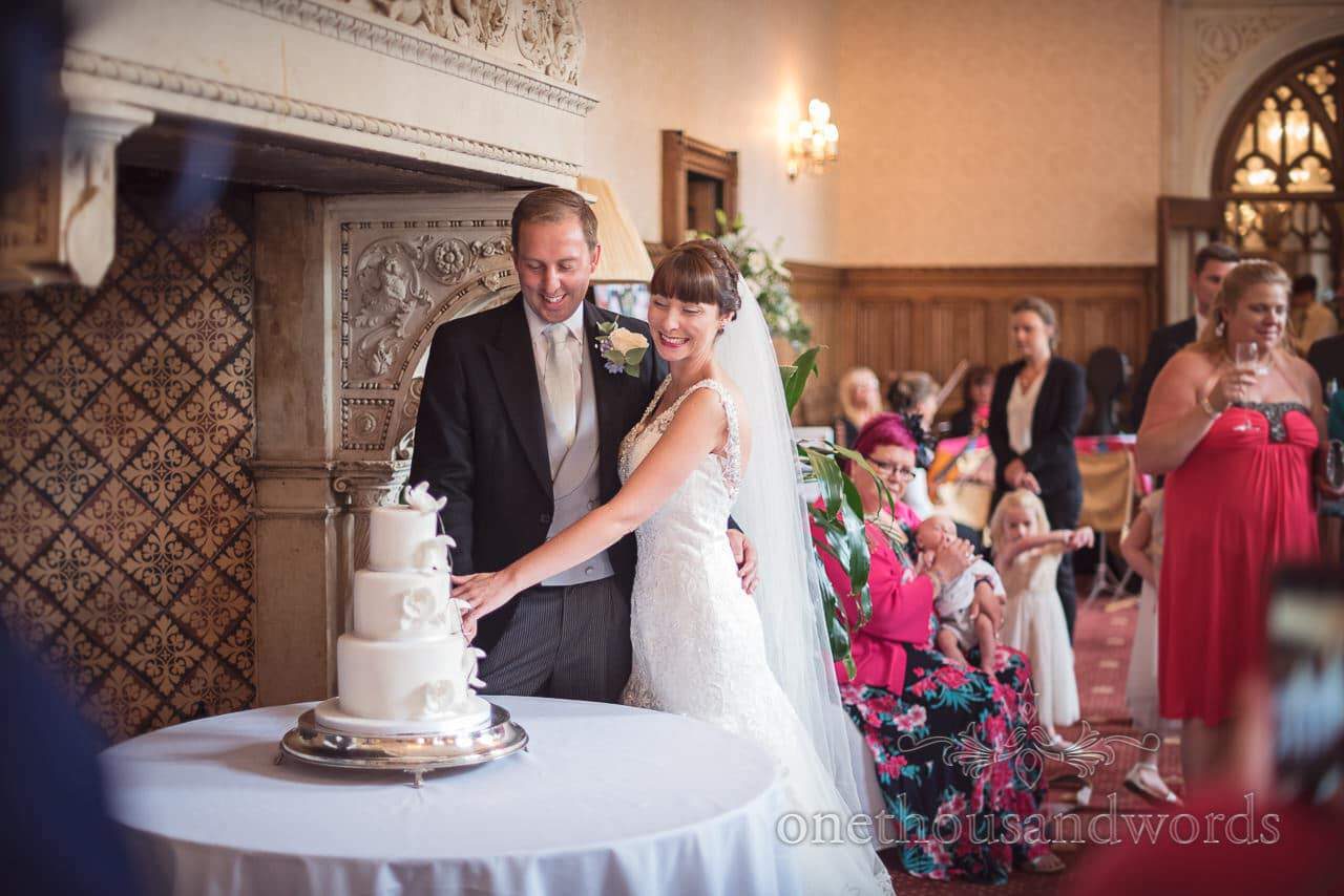 Bride and groom cut the cake at Canford School Wedding Photographs