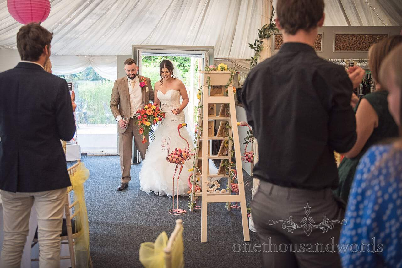 Bride and groom enter the marquee at The Old Vicarage Wedding Photographs