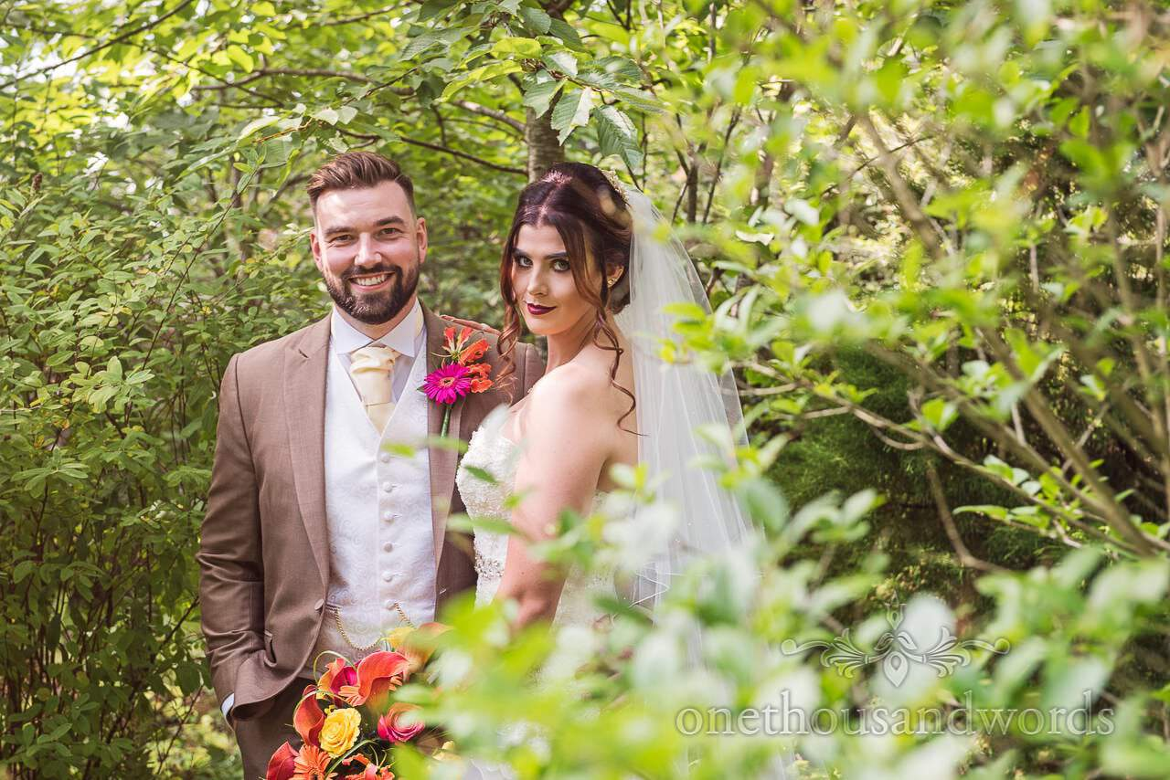 Bride and groom in botanical garden at The Old Vicarage Wedding Photographs