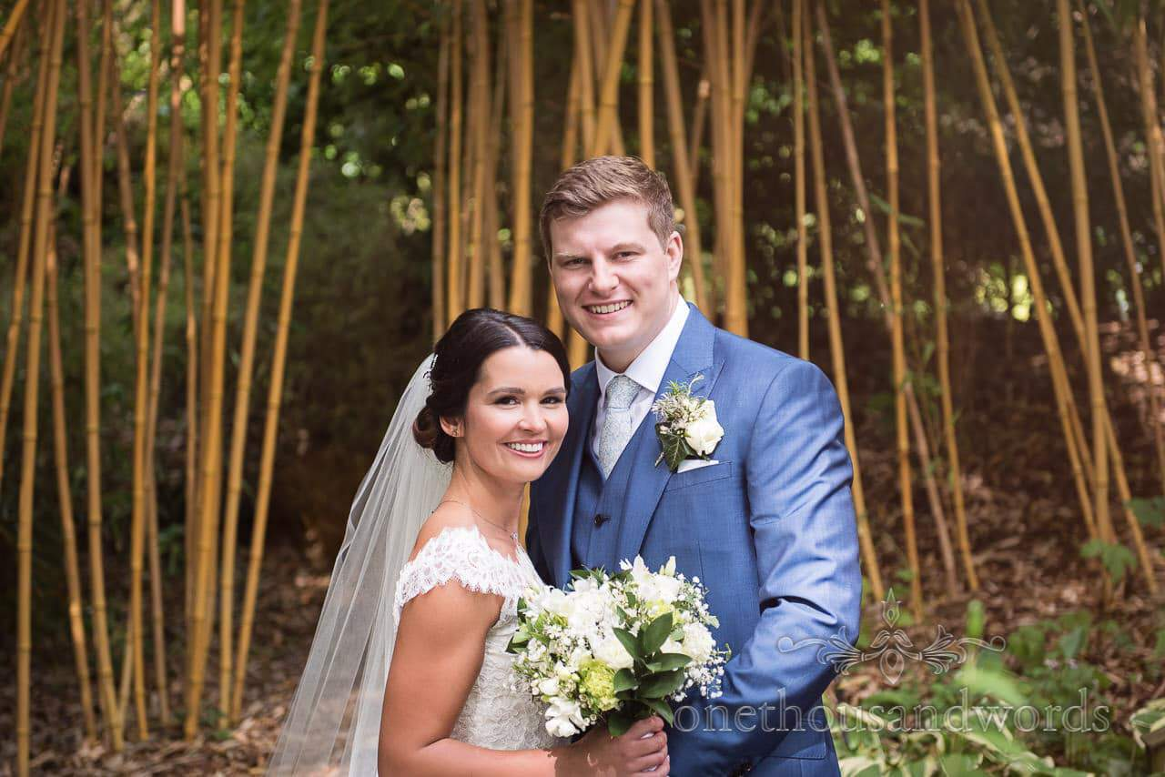 Bride and groom in front of bamboo in Japanese gardens at The Italian Villa Wedding