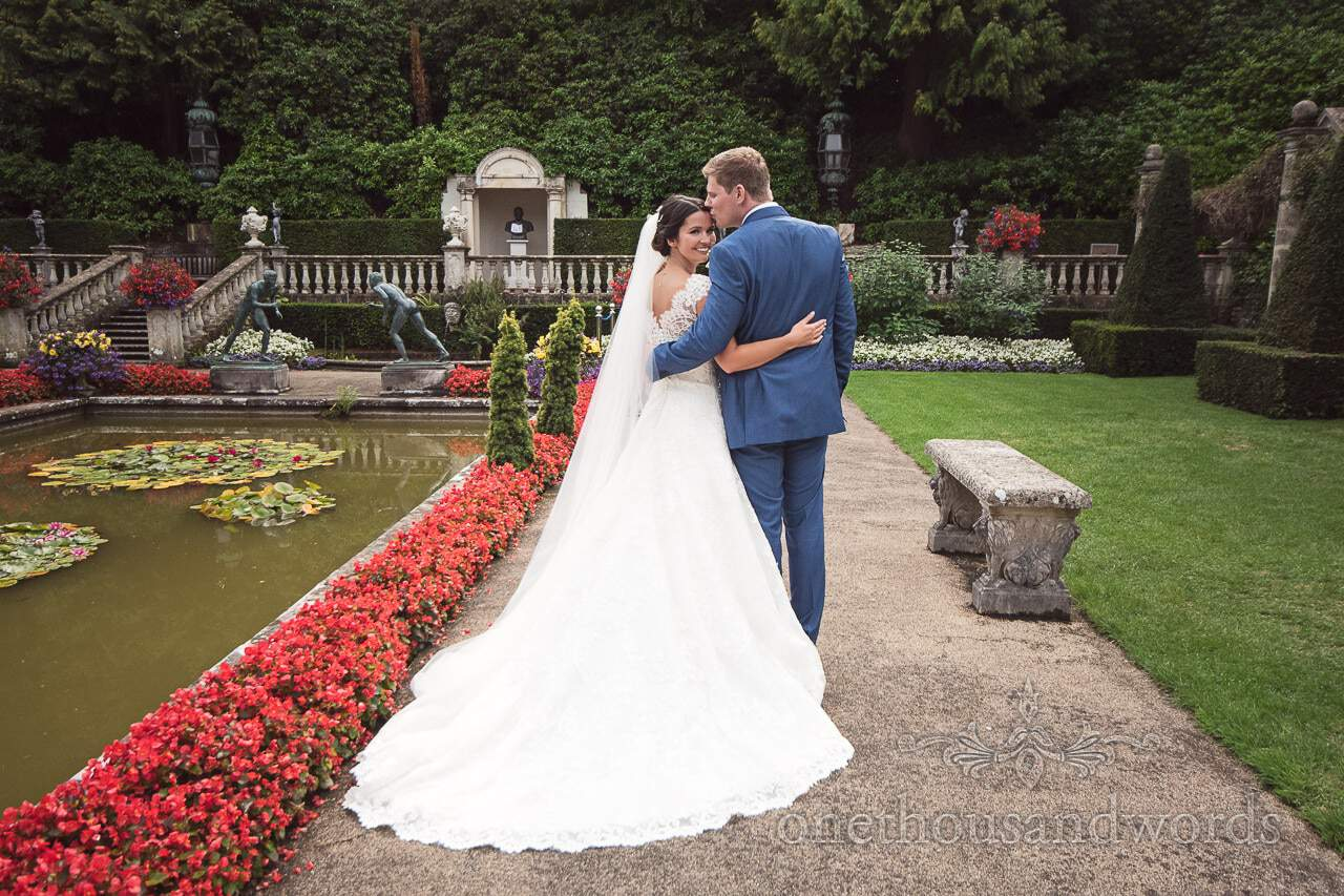 Bride and groom in the Italian Gardens at The Italian Villa Wedding venue